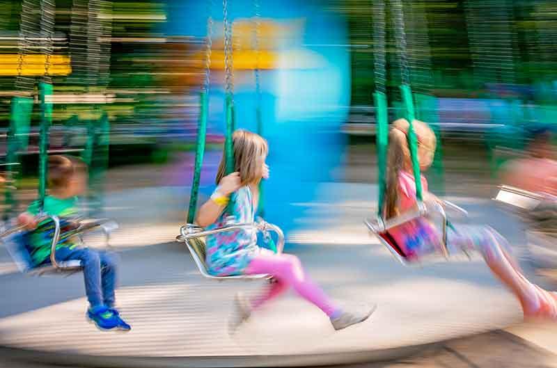 children on a carousel